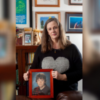 The author holding a photo of her son