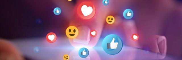 Emojis floating over tablet.
