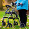 Woman using a walker in the grass.