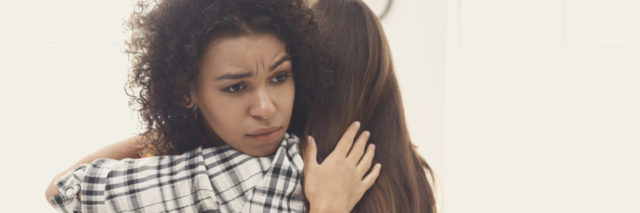 Woman hugging friend for support