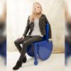 Woman sitting on Mannequal mannequin wheelchair.