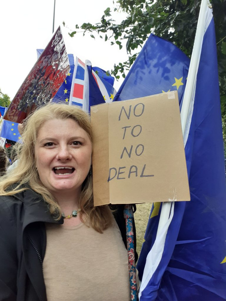 """photo of woman at Brexit protest holding sign which says """"no to no deal"""""""