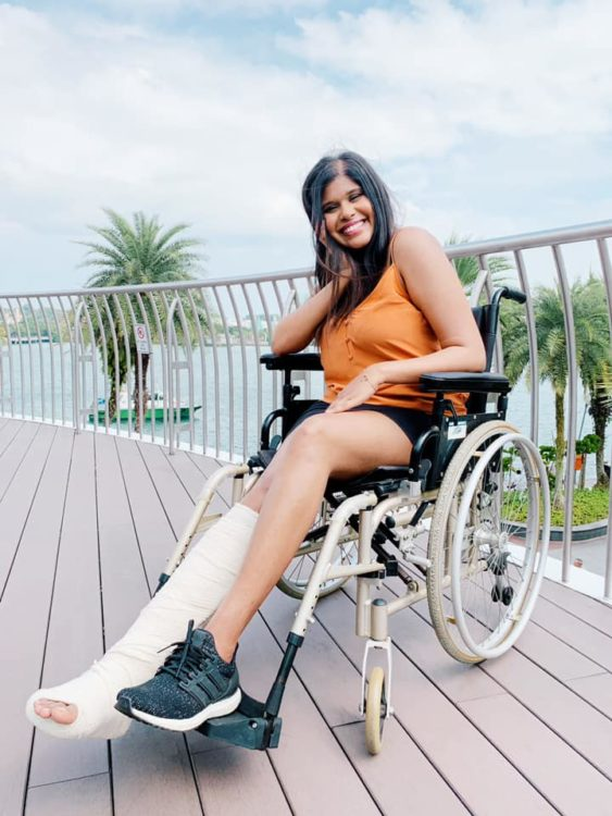 Maneka K. in her wheelchair