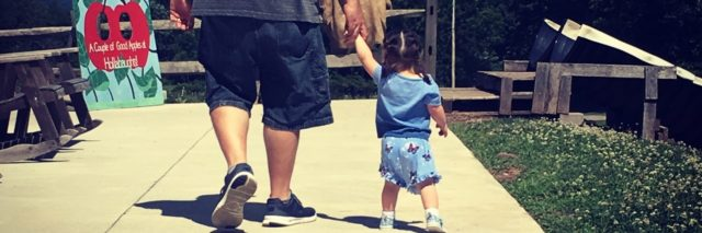 Kelly's daughter walking with her father.