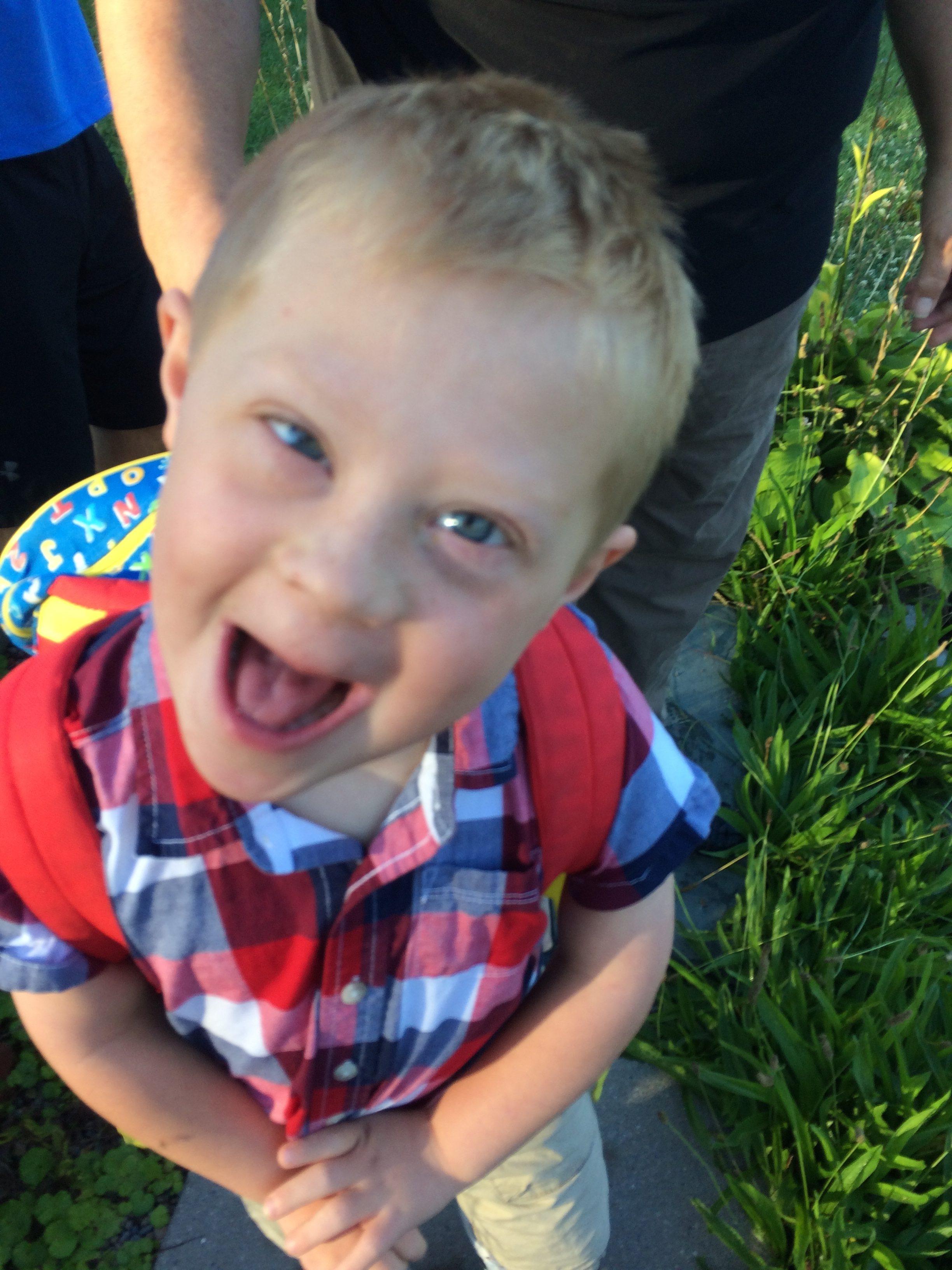 Beth's son making a goofy happy face.