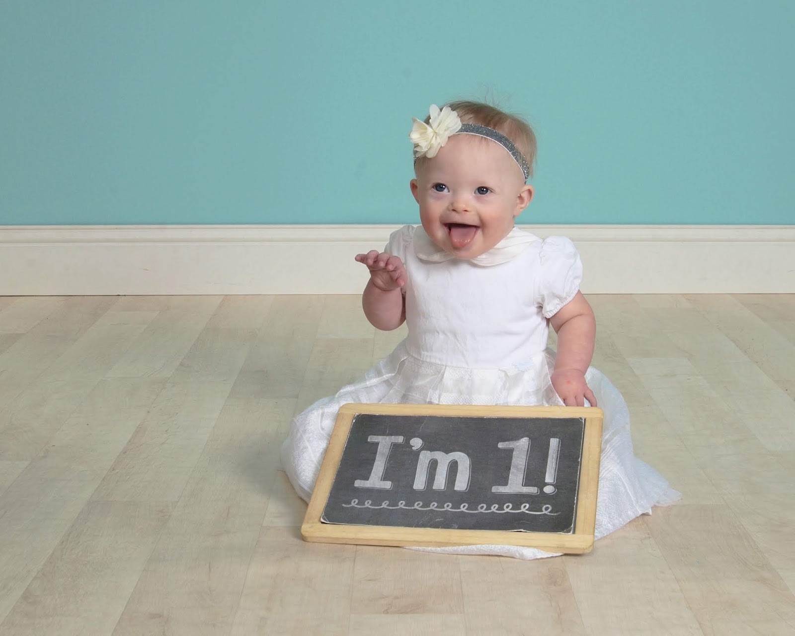 """Alice with a sign saying """"I'm 1!"""""""