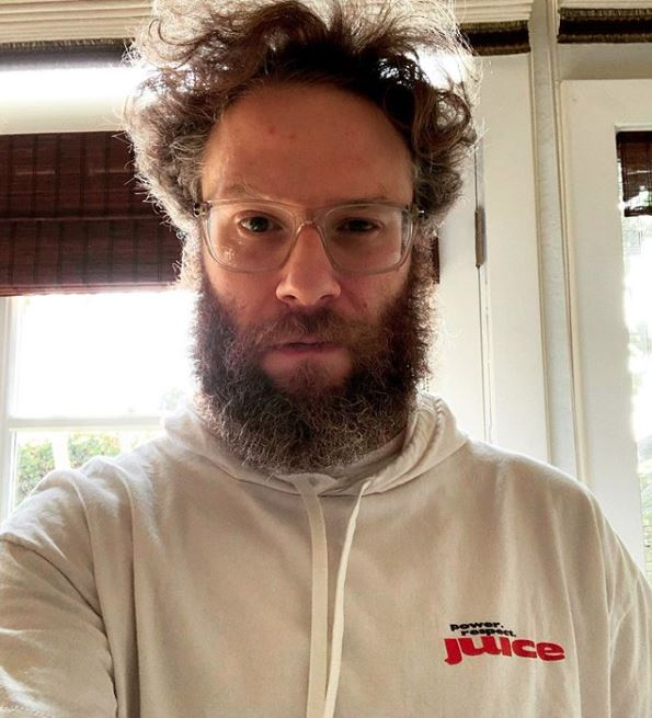 seth rogan with glasses in sweatshirt looking at camera