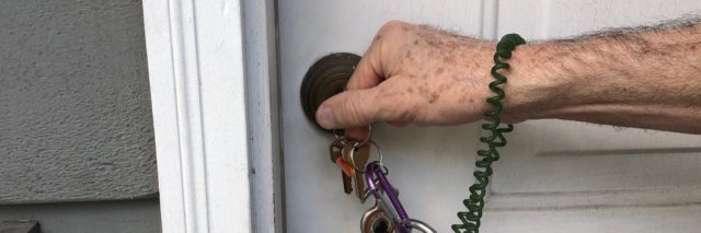 Close up of the author's hand unlocking the door