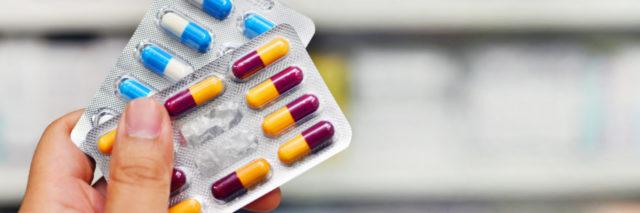 Hand holding medicine capsule pack