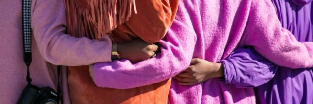a group of women embracing in support