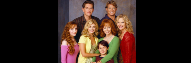 The cast from the TV show 'Reba' pose for a photo.