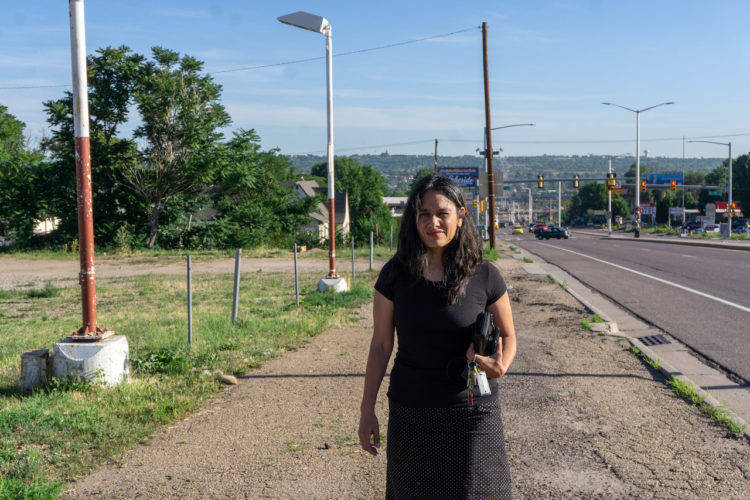 Janet van der Laak walks on Federal Boulevard in Denver looking for her son, Matt Vinnola, on July 19, 2019.