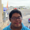 Raymond, a teen with Down syndrome at the airport.