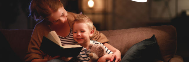 Mom reading to her son.