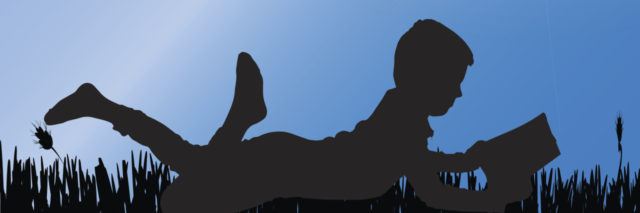 Silhouette of boy reading.