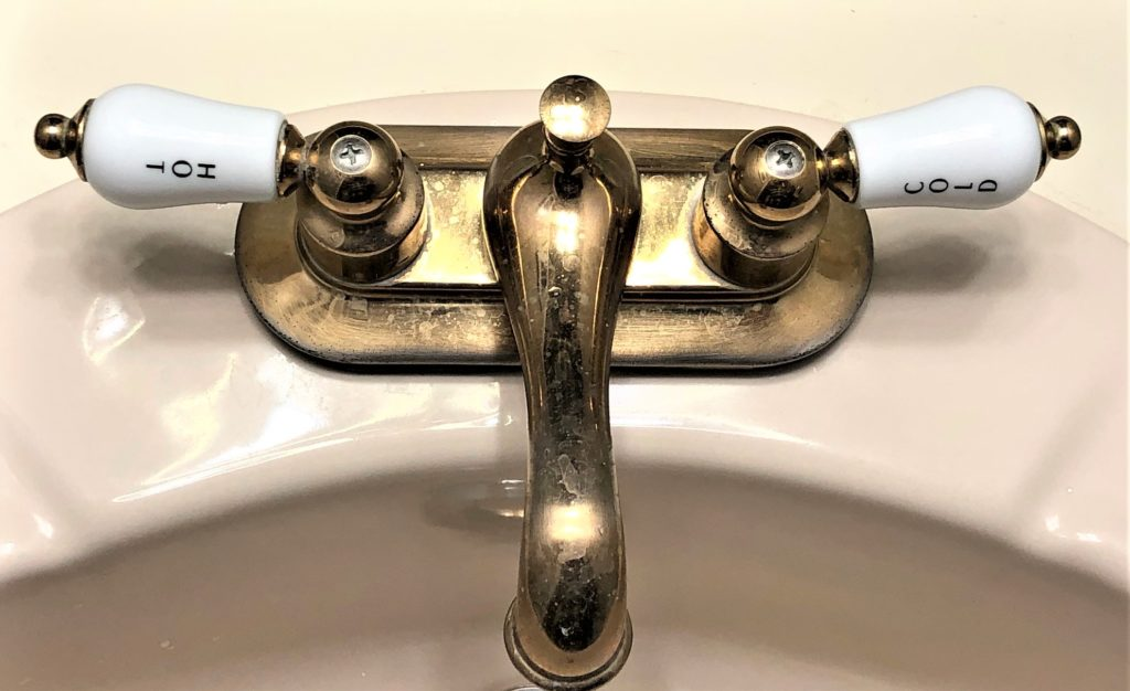 photo of faucet with hot and cold taps