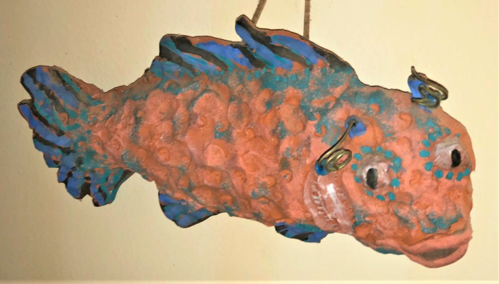 photo of orange and blue fish decoration on wall