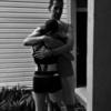Gelcys embracing her husband while wearing her running attire.