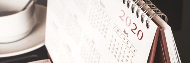 Desktop calendar sitting on desk showing year 2020.