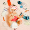 Ivy, a baby with Down syndrome surrounded by her tube feeding supplies.