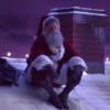 Santa sitting on roof