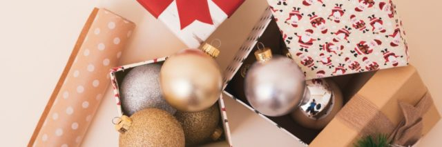boxes of ornaments and wrapping paper