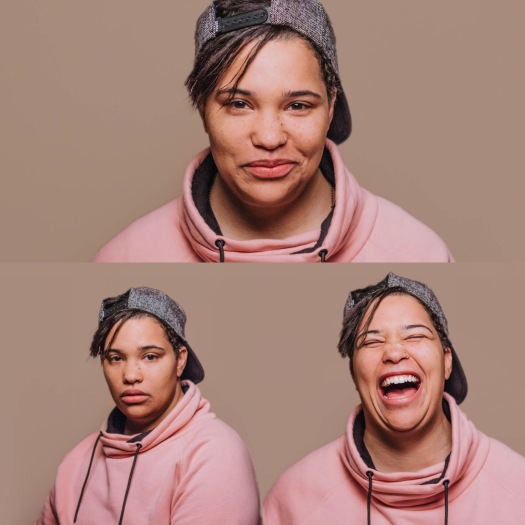 three headshots of character with various expressions. the top is smiling, the bottom left is serious and the bottom right is laughing