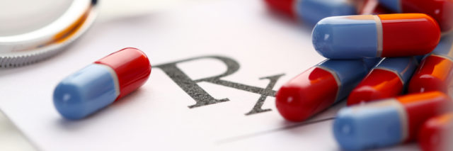 Crohn's disease Rx prescription pills and bottle.