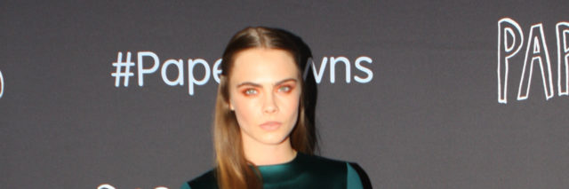 Cara Delevingne on the red carpet in a green dress