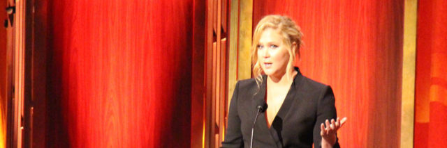 Amy Schumer accepted a Peabody Award in a black suit dress