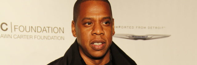 Jay-Z, dressed in black, at an event for his foundation