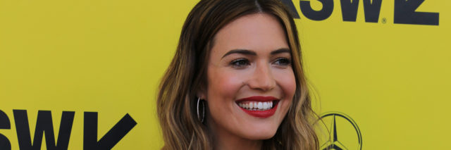 Mandy Moore poses on the red carpet in a red dress