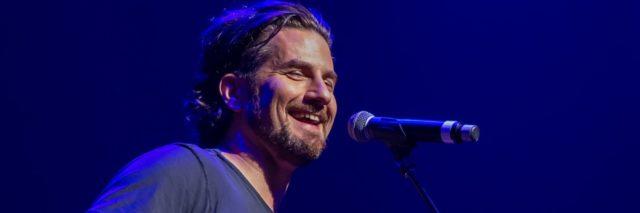 Matt Nathanson performs at a concert with a guitar