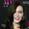 Mandy Moore looks ahead on the red carpet in a black dress