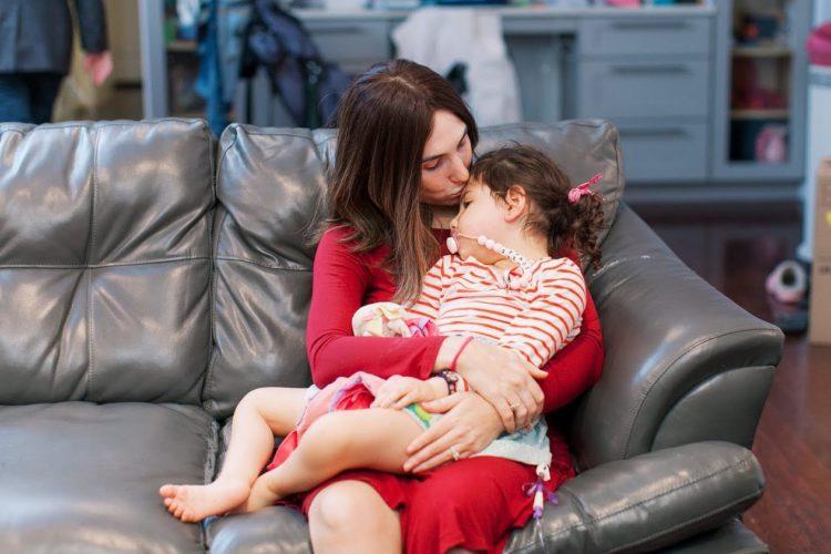 Randi holding her daughter Sonzee