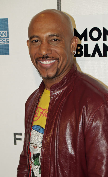 Montel Williams in a red leather jacket on the red carpet