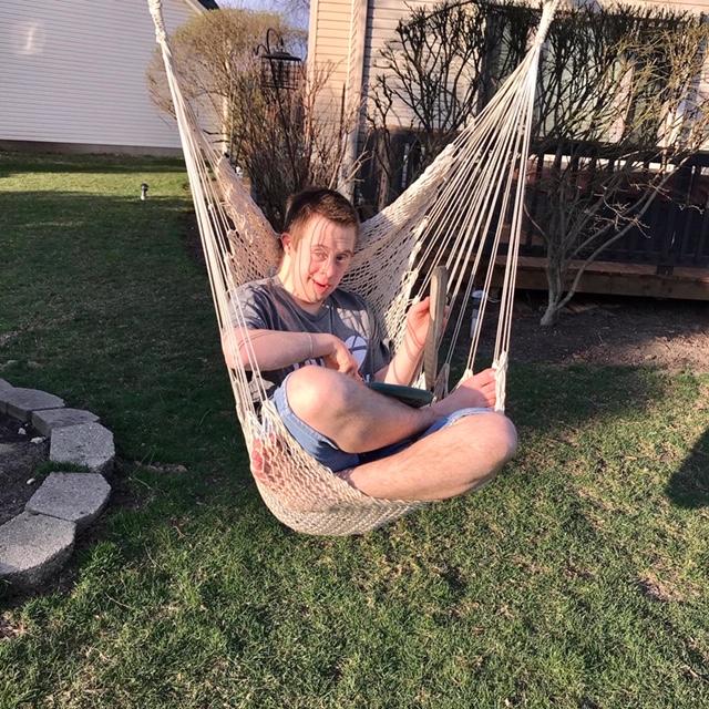 Nick in his swing in the backyard.