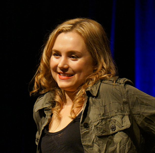 Rachel Miner smiles at the crowd from onstage