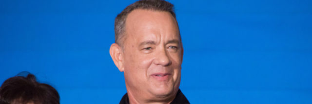 Tom Hanks in a black shirt at a promotional event for a film