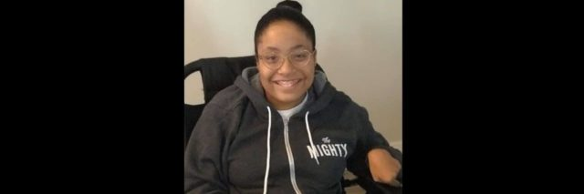 """A woman wearing a sweatshirt that says """"The Mighty."""""""