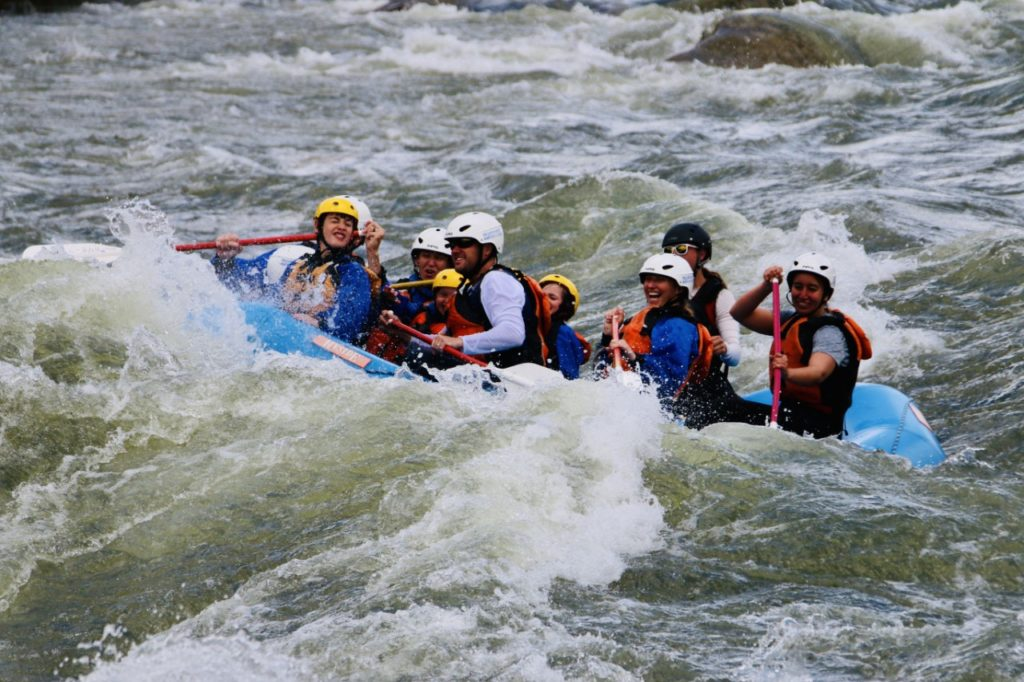 photo of contributor and her family white water rafting