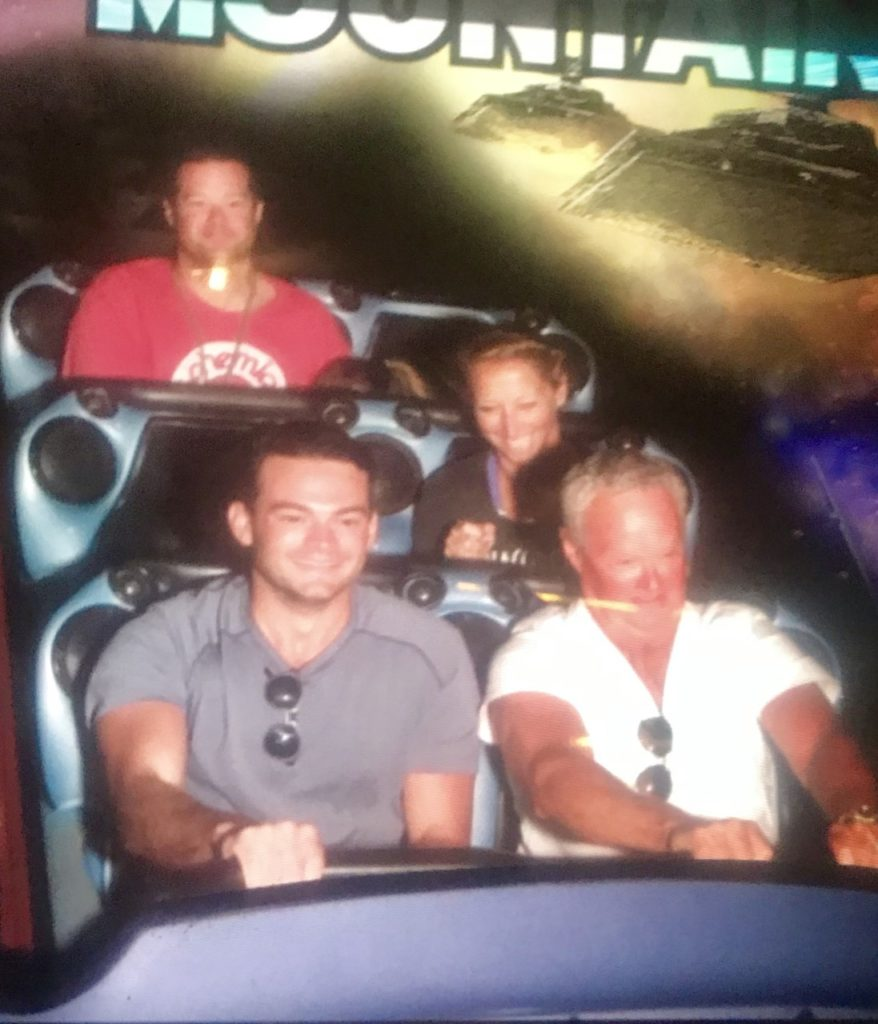 photo of the contributor and family on Space Mountain at DIsneyland