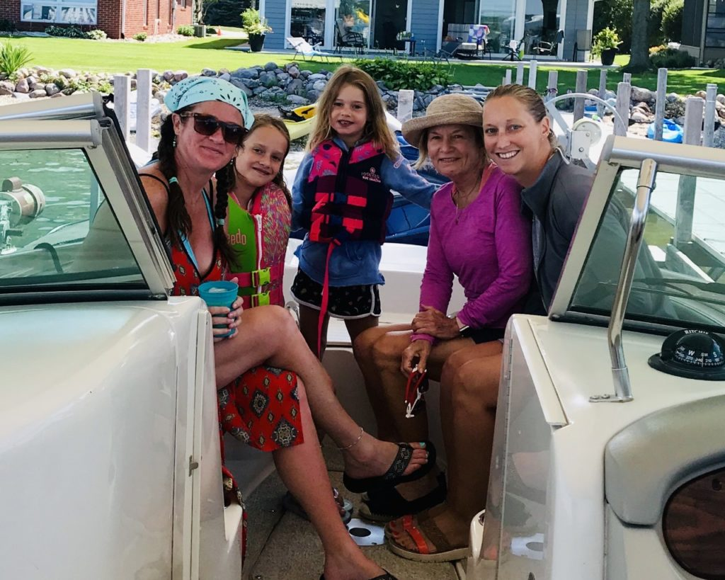 photo of the contributor and family on a lake boat