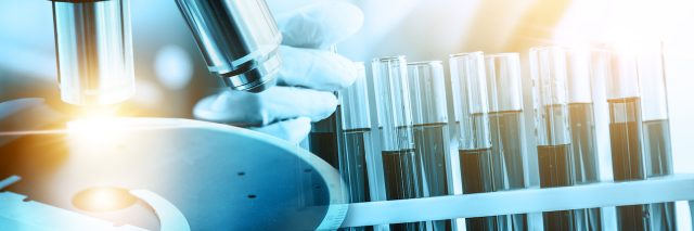 Image of scientific and medical lab instrument, microscope, test tube and glass flask