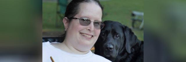Miriam with her Labrador retriever service dog, Yahtzee.