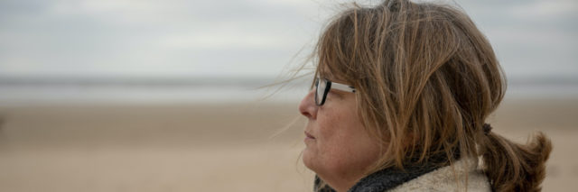 Woman at the beach in winter
