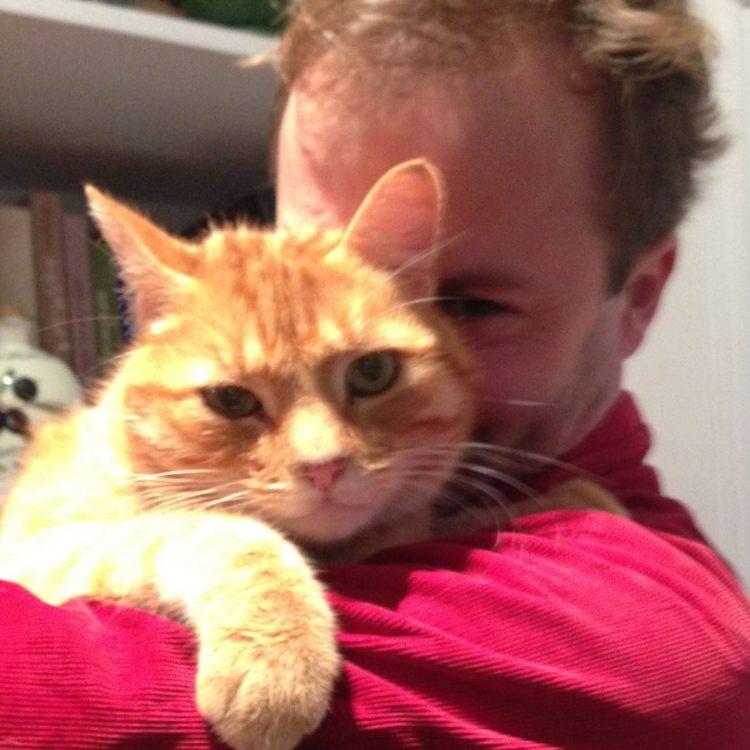 Contributor with his orange cat