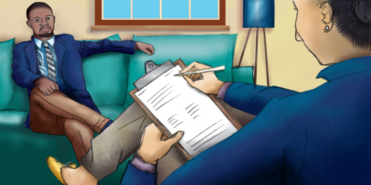A female therapist wearing a blue blazer and taking notes on a clipboard sits across from a Black man on a teal couch in the therapy room