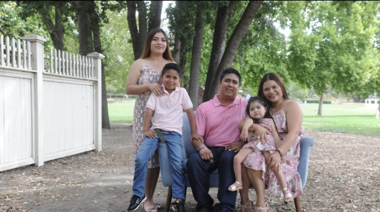 Karla Garcia, right, with her daughter Brianna and the rest of her family: husband Rigoberto Cordova, oldest daughter Karla Patricia Cordova and son Justin Cordova. (Photo by Moment by Moment Photography).