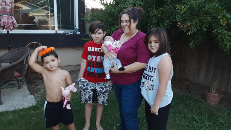 Leticia DeGracia of Sacramento with children Brandon, 4, Andrew, 10, infant Gloria, and Jacqueline DeGracia, 8. DeGracia said she had to fight for months to get Brandon enrolled in Medi-Cal so he could receive therapy for autism. Photo courtesy of Leticia DeGracia.